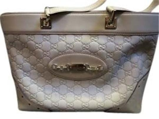 Preload https://item2.tradesy.com/images/gucci-white-guccisima-leather-tote-22731-0-0.jpg?width=440&height=440