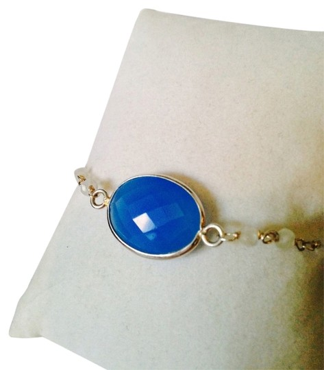 Preload https://item2.tradesy.com/images/js-collections-bluesilver-faceted-and-white-chalcedony-gemstone-in-sterling-bracelet-2273811-0-0.jpg?width=440&height=440
