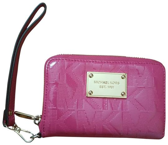e6898ddcd11b Shoptagr | Hot Pink Zipped Wristlet Wallet by Michael Kors