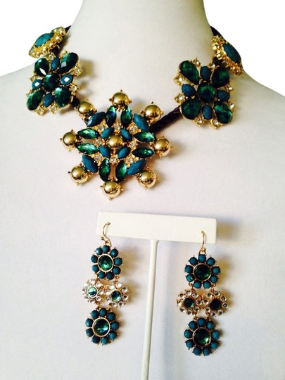 Preload https://item4.tradesy.com/images/neiman-marcus-shades-of-bluegold-2-piece-set-nwot-faceted-crystals-on-rope-necklace-and-earrings-2274658-0-0.jpg?width=440&height=440