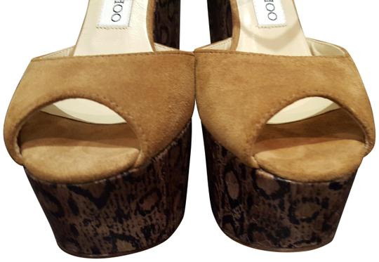 Preload https://item5.tradesy.com/images/jimmy-choo-tan-folly-suede-whisky-313435-wedges-size-eu-37-approx-us-7-regular-m-b-22751519-0-1.jpg?width=440&height=440