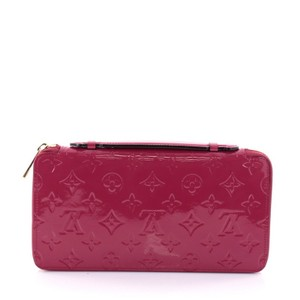 Louis Vuitton Daily Organizer Wristlet in magenta