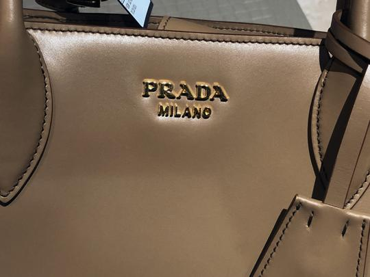c6bd6f7cbab8a4 Prada Made In Italy Bibliotheque Double Handle Golden Hardware Shoulder  Tote in Caramel / White Image