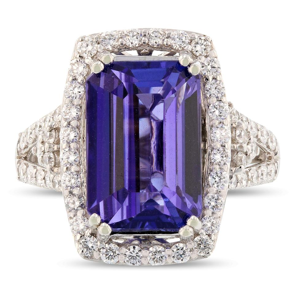 a set flanked by s platinum blue powerful glacier two adorn the exotic in tanzanite gia and gemvara ring is topaz