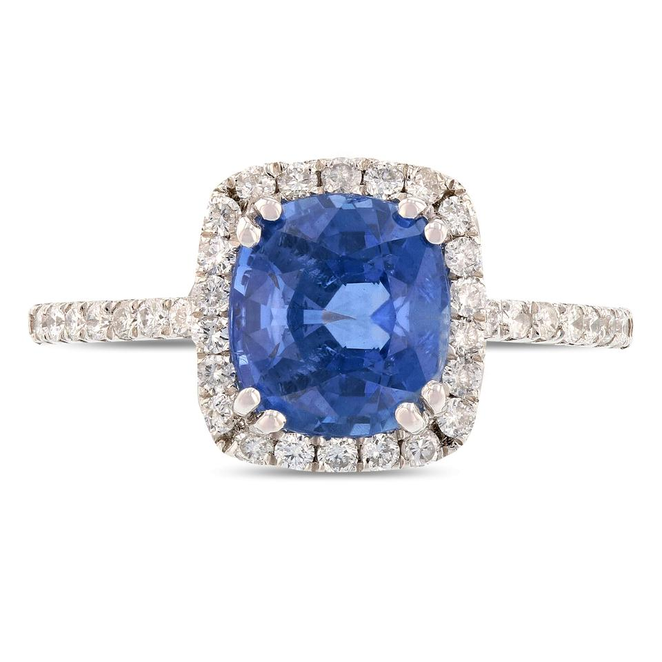 reminds rare pin that blue center northern in sapphire is a flower of the composition