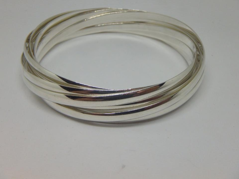 b5d999c77 Paloma Picasso Melody sterling silver 9 band medium size bangle Image 6.  1234567