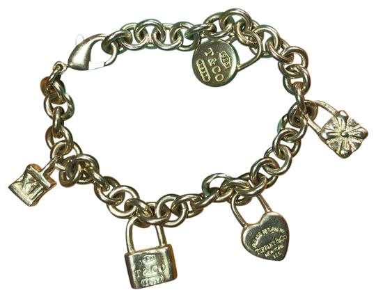 Preload https://img-static.tradesy.com/item/22784242/tiffany-and-co-silver-icons-lock-charm-bracelet-0-1-540-540.jpg