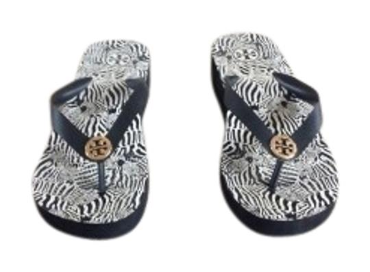 Preload https://item1.tradesy.com/images/tory-burch-black-sandal-wedges-size-us-6-regular-m-b-22785-0-1.jpg?width=440&height=440