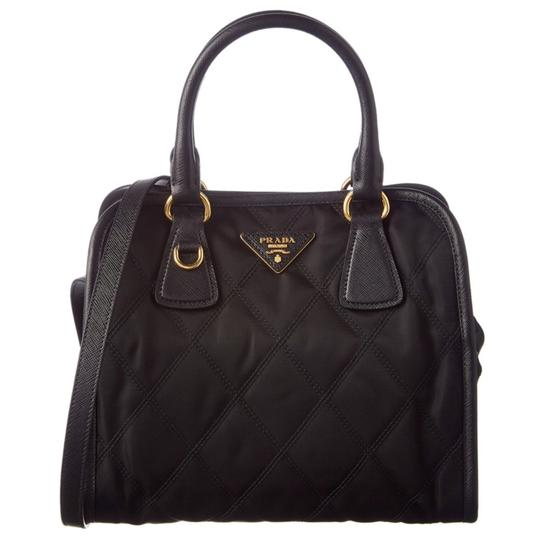 Preload https://img-static.tradesy.com/item/22788585/prada-quilted-black-nylon-and-leather-strap-cross-body-bag-0-1-540-540.jpg