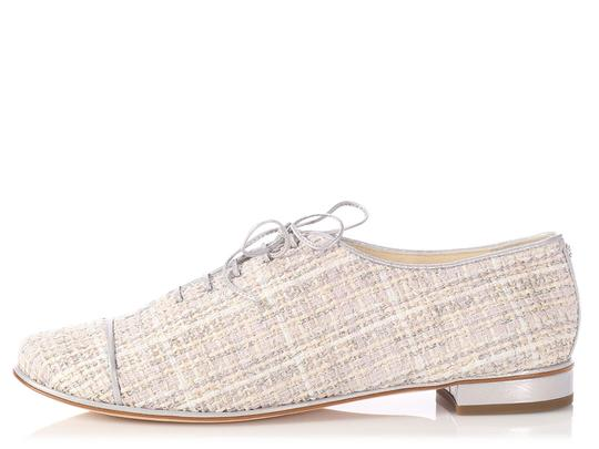 Preload https://img-static.tradesy.com/item/22799630/chanel-cream-and-silver-lace-up-tweed-flats-size-eu-42-approx-us-12-regular-m-b-0-0-540-540.jpg
