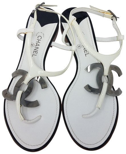 Preload https://img-static.tradesy.com/item/22800392/chanel-white-silver-patent-leather-thong-interlocking-cc-sandals-size-eu-36-approx-us-6-regular-m-b-0-2-540-540.jpg