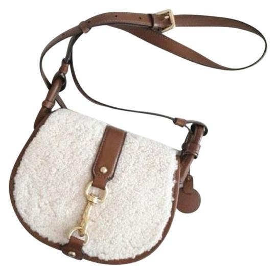Preload https://img-static.tradesy.com/item/22800929/michael-kors-jamie-saddle-leather-caramel-purse-white-and-brown-shearling-wool-cross-body-bag-0-1-540-540.jpg