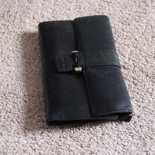 Fossil bi fold and check book holder