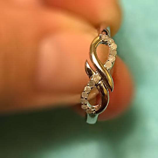 9.2.5 (.20ctw) 925 SS infinity bypass ring