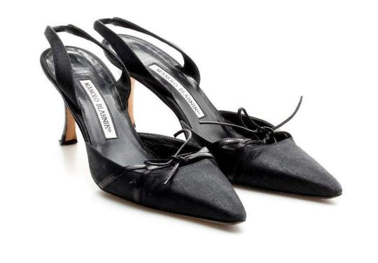 Preload https://item5.tradesy.com/images/manolo-blahnik-black-canvas-bow-slingback-pumps-size-eu-365-approx-us-65-regular-m-b-22802259-0-0.jpg?width=440&height=440