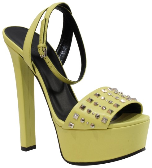 Preload https://item4.tradesy.com/images/gucci-yellow-374523-studded-leather-sandals-38585-platforms-size-us-85-regular-m-b-22802313-0-1.jpg?width=440&height=440