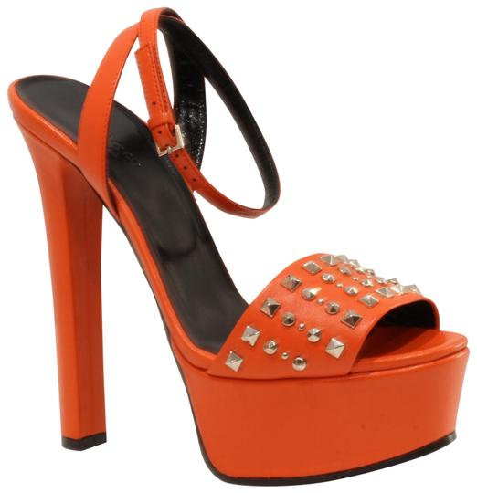 Preload https://item5.tradesy.com/images/gucci-orange-studded-leather-sandals-37575-platforms-size-us-75-regular-m-b-22802489-0-1.jpg?width=440&height=440