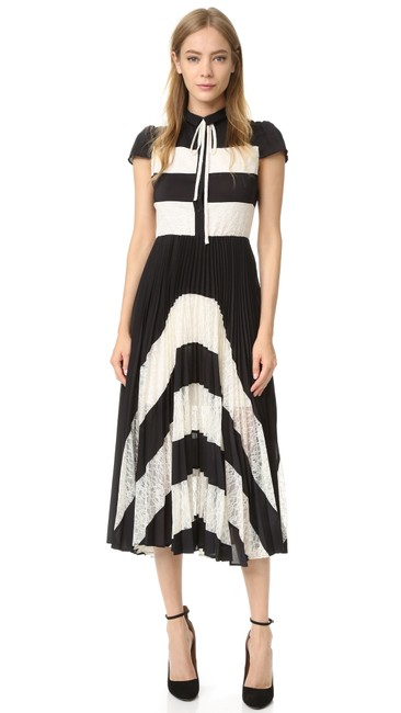 Preload https://item3.tradesy.com/images/alice-olivia-gale-cap-sleeve-pleated-lace-panel-midi-mid-length-short-casual-dress-size-0-xs-22802542-0-0.jpg?width=400&height=650