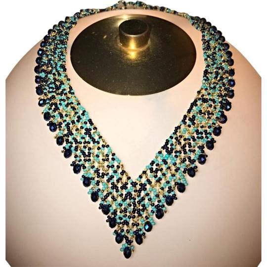 Preload https://item5.tradesy.com/images/turquoise-blue-coral-seed-bead-elegant-necklace-22802669-0-1.jpg?width=440&height=440