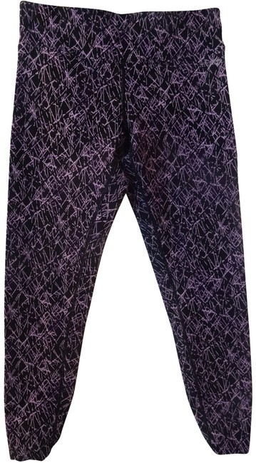 Preload https://img-static.tradesy.com/item/22802830/calvin-klein-black-with-purples-and-pinks-performance-activewear-leggings-size-8-m-29-30-0-1-650-650.jpg