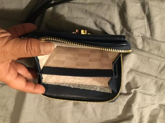 Michael Kors Leather Logo Hardware Wristlet in Navy Blue with Gold & Black Studded MK Log