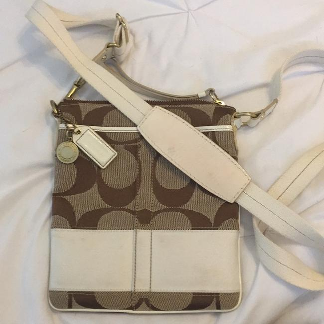 Coach Swing Tan Logo and White Leather Canvas Cross Body Bag Coach Swing Tan Logo and White Leather Canvas Cross Body Bag Image 1