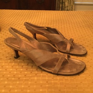 Donald J. Pliner Suede Goldish tan color. Color is very versatile and goes great with jeans, too! Sandals