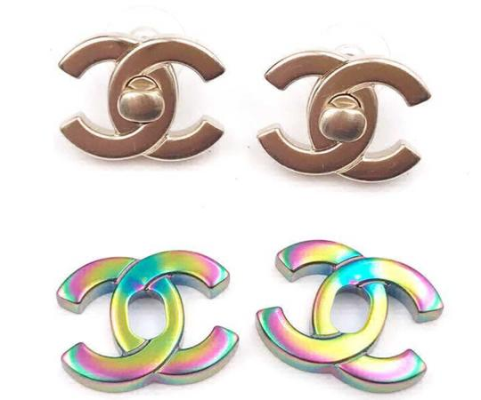 Preload https://img-static.tradesy.com/item/22813965/chanel-gold-iridescent-rare-classic-turnlock-exchangeable-piercing-earrings-0-0-540-540.jpg