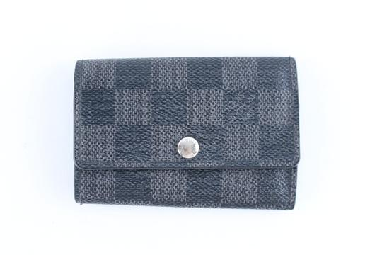 Preload https://img-static.tradesy.com/item/22820204/louis-vuitton-damier-multicles-key-holder-224783-graphite-coated-canvas-clutch-0-0-540-540.jpg