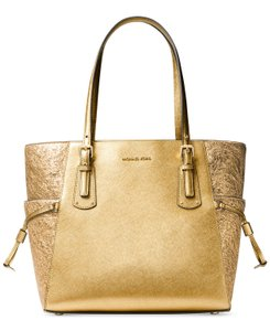 Michael Kors Leather Voyager Leather Tote in Gold