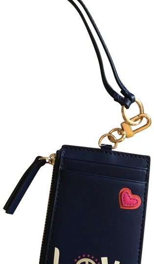 Preload https://img-static.tradesy.com/item/22823290/tory-burch-navy-laynard-id-peace-0-2-540-540.jpg