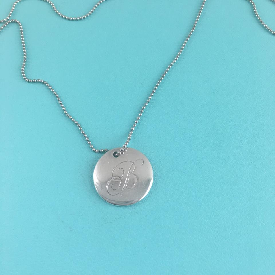 Tiffany co silver initial alphabet b round 075 disc pendant tiffany co silver initial alphabet aloadofball Images