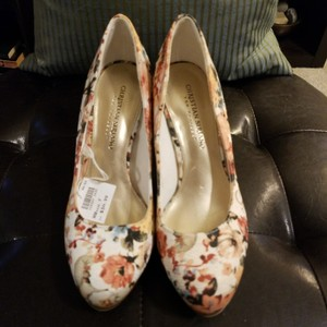 Christian Siriano for Payless Ivory grossgrain fabric with neutral floral print. Very pretty, pallette is very versatile and will fit into many wardrobes. Platforms