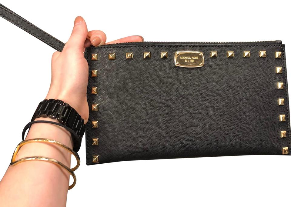 d63917efe04d ... Clutch Michael Kors Wristlet in Black and golden studs .