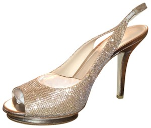 Pelle Moda I have gold and sliver Pumps