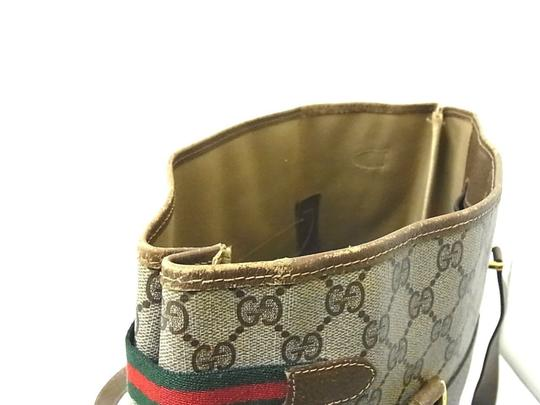 Gucci Interior Pockets Great For Everyday Excellent Vintage Tote in leather & large G logo print coated canvas in shades of brown Image 1