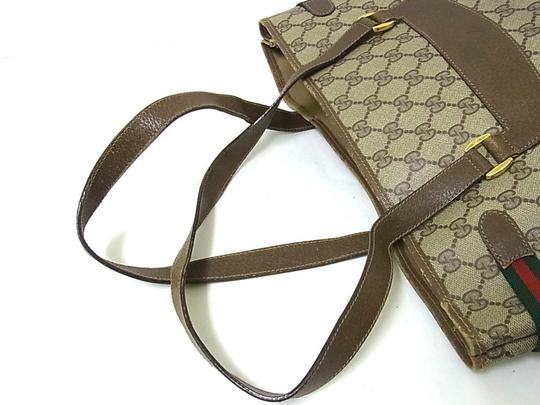 Gucci Interior Pockets Great For Everyday Excellent Vintage Tote in leather & large G logo print coated canvas in shades of brown Image 3