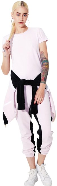 Preload https://img-static.tradesy.com/item/22836202/juicy-couture-pink-black-label-peek-a-boo-velour-sleeve-with-removable-shoulder-padding-tee-shirt-si-0-2-650-650.jpg