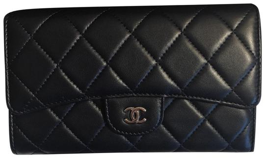 Preload https://item5.tradesy.com/images/chanel-navy-blue-classic-trifold-flap-lambskin-silver-hardware-wallet-22854699-0-1.jpg?width=440&height=440