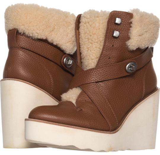 Preload https://item4.tradesy.com/images/coach-brown-saddle-kenna-wedge-shearling-ankle-575-saddlenatural-bootsbooties-size-us-9-regular-m-b-22855303-0-1.jpg?width=440&height=440