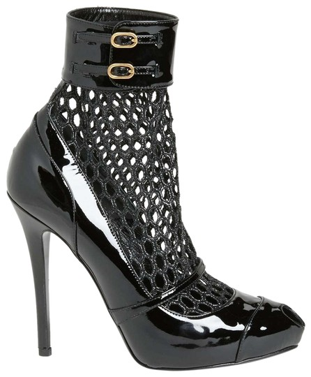 Preload https://item1.tradesy.com/images/alexander-mcqueen-black-honeycomb-patent-leather-bootsbooties-size-eu-415-approx-us-115-regular-m-b-22855395-0-1.jpg?width=440&height=440