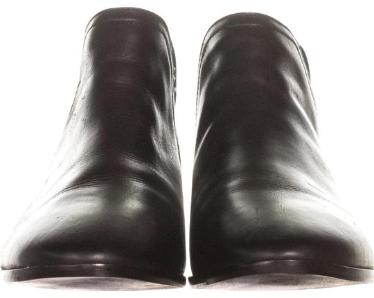 Preload https://item1.tradesy.com/images/kenneth-cole-black-reaction-loop-there-it-is-cutout-ankle-453-bootsbooties-size-us-9-regular-m-b-22855505-0-1.jpg?width=440&height=440