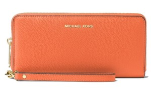 Michael Kors Michael Kors Mercer Travel Continental Orange Leather Wallet Wristlet