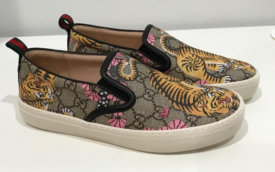 75f2a378e6c Gucci Multi-color 454380 Women s Gg Supreme Lion Webstripe Slip On ...