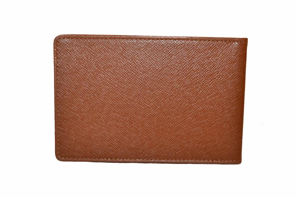 c3ee2eb5a16f ... Louis Vuitton Brown Taiga Leather ID Holder Image 8. 123456789