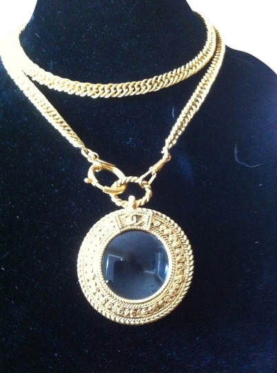 Preload https://item4.tradesy.com/images/chanel-gold-iconic-gold-tone-w-magnifying-glass-loupe-pendant-necklace-2286558-0-0.jpg?width=440&height=440
