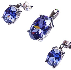 9.2.5 Stunning tanzanite oval earrings and pendant set.
