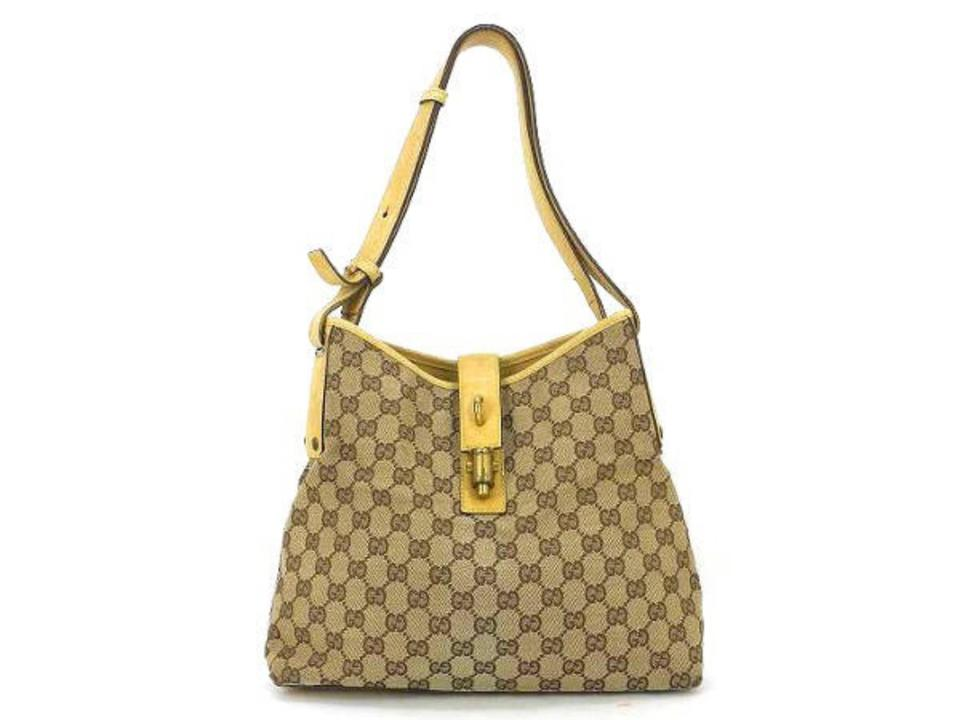 bd4ab090ba34 Gucci Jackie Piston Lock 223835 Beige X Yellow Coated Canvas Hobo Bag