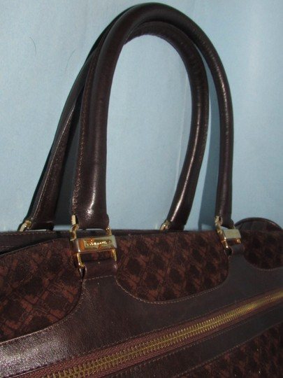 Salvatore Ferragamo Multiple Pockets Mint Condition Early Gold Vera Accents Great For Everyday Satchel in rich shades of brown logo print suede and browm leather Image 2