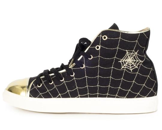 Preload https://img-static.tradesy.com/item/22876834/charlotte-olympia-black-and-gold-canvas-web-high-top-sneakers-sneakers-size-eu-37-approx-us-7-regula-0-0-540-540.jpg